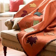 This cozy leaf blanket looks perfect  for a post-Thanksgiving turkey nap. Get instructions here: http://www.bhg.com/thanksgiving/crafts/fall-leaf-applique-blanket/?socsrc=bhgpin103012fallblanket