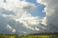 Fine art canvas print of blue sky and dramatic storm clouds over Maine.