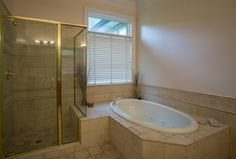 Traditional Master Bathroom with limestone tile floors, High ceiling, Master bathroom, Crown molding, Wall sconce