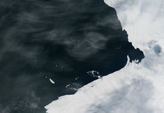 Image from orbit of Antarctic coast with piece of glacier breaking free
