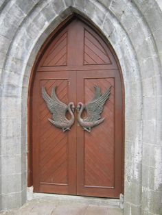 Ireland~ The door handles on the church were a gift from the government of Western Australia - black swans.