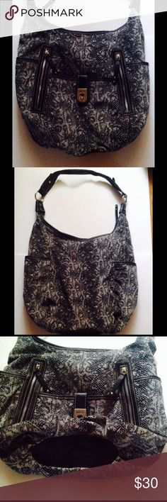 Rosetti hobo bag Rosetti bag, nwot, lots of pockets, interior has 2 pockets on one side and zip pocket on other. Soft material.  Black and white snakeskin pattern Rosetti Bags Hobos