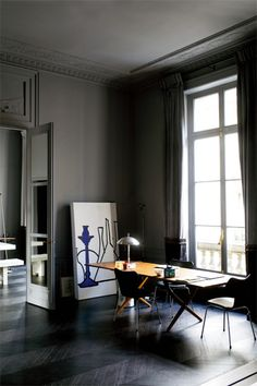 Apartment interior in Paris by Florence Baudoux: Teak dining table by Danish designer, Hans J. Wegner, model AT 303 for Andrea Tuck, Denmark, 1955. / Planete Deco