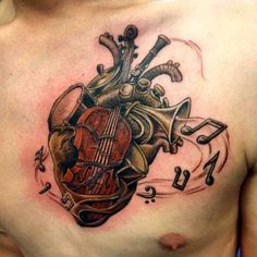 Musical instrument human heart tattoo.