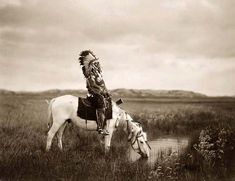 """Oglala Sioux Indian man (Red Hawk).  Oglala Sioux meaning """"to scatter one's own"""" in Lakota language, are one of the seven subtribes of the Lakota people, who along with the Nakota and Dakota, make up the Great Sioux Nation."""