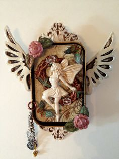Faerie with butterflies in Altoid tin shrine... 20.00, via Etsy.