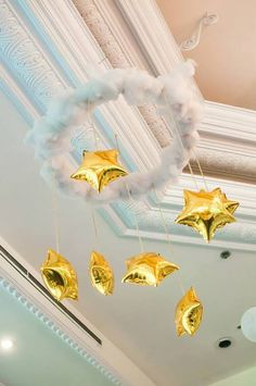 Hang it from the ceiling for a stellar DIY chandelier! | Heavenly Details | 7 Twinkly Inspirations for a Wish Upon A Star Baby Shower