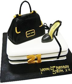 0d7787a2a1c2 Elegant black and white themed 21st birthday cake decorated with a black  handbag and shoe.