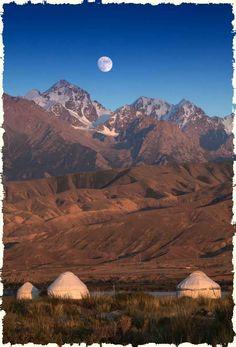 Mongolian Landscape. Gers at the base of the mountain. https://ExploreTraveler.com