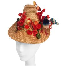 1940s Straw Hat w/ Bird and Flower Embellishment | From a collection of rare vintage hats at https://www.1stdibs.com/fashion/accessories/hats/