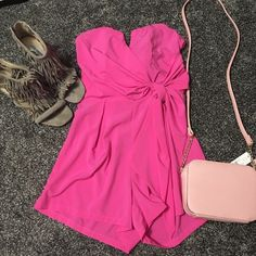 Strapless hot pink romper NWOT bought it and never wore it, zips up the back, has bow in the front, also has a v cut out in the front, top has somewhat of a built in corset, open to reasonable offers, no trades Charlotte Russe Other