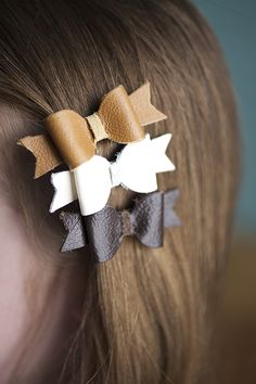 Itty bitty bows made with free leather swatches from West Elm