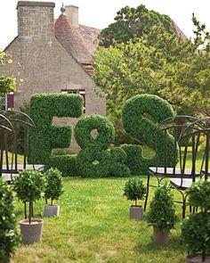 #green #outdoor #wedding #ceremony #aisle #flower #wall #floral #arrangement #boxwood #letter #decor
