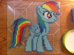 {Perler} Rainbow Dash by OddishCrafts on DeviantArt Fuse Bead Patterns, Perler Patterns, Beading Patterns, Cross Stitch Patterns, Perler Bead Disney, Perler Bead Art, Rainbow Dash, Modele Pixel Art, Nerd Crafts