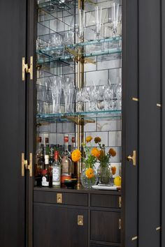 Chic kitchen features an dark brown bi fold doors opening to an espresso stained built-in bar cabinet adorned with brass vintage inset hardware… Bar Interior, Modern Interior, Interior Design, Ad Design, Home Bar Decor, Home Decor Kitchen, Kitchen Design, Bar Kitchen, Hotel Decor