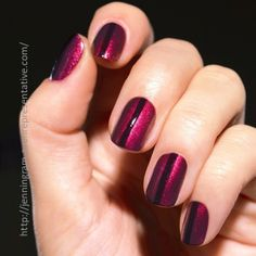 We can't get enough of these shimmery ruby red nails!