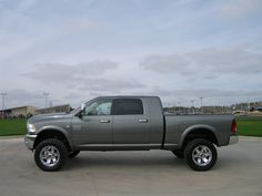 "2012 Ram 2500 LH  4"" Lift Kit, 35"" Toyo Tires,  20"" XD Series Wheels,  AMP Research Power Boards  www.peterscars.com"
