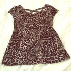Leopardprint scoop back shirt City of stretchy material seen on the front very flattering. Scoop back with crosses on super cute shirt can be dressed up and dressed down. Worn a couple times that great condition, many compliments when worn! Only getting rid of because it doesn't fit anymore. Tops Blouses