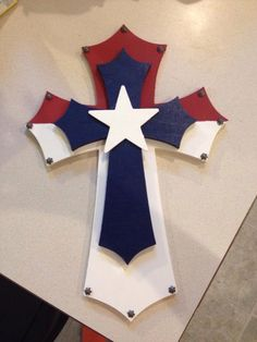 make a snaller white cross for center: Red white and blue cross FREE: Access Our Brand New WoodCrafting Guide Cross Wall Decor, Crosses Decor, Wall Crosses, Mosaic Crosses, White Crosses, Americana Crafts, Patriotic Crafts, July Crafts, Texas Crafts