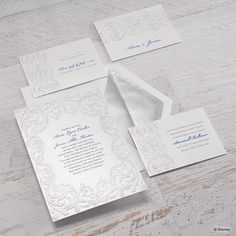 Elaborate embossing with a touch of color turns these white shimmer wedding invitations into a beautiful work of art! The vintage flourishes twist and turn gracefully around your wording, which is printed in your choice of colors and lettering styles.