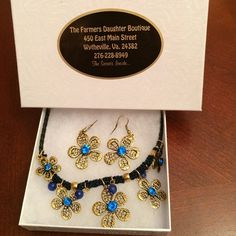 Necklace and earring set Blue and antique gold flower necklace and earrings set. Never been worn. Farmers Daughter Boutique Jewelry Necklaces