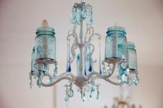 32 Ways to Redo, Reuse, Repurpose Vintage Mason Canning Jars- Great idea for my chicken chandelier for the patio. solar lights in jar Vintage Mason Jars, Blue Mason Jars, Bedroom Vintage, Mason Jar Chandelier, Bottle Chandelier, Baby Food Jars, Ball Jars, Canning Jars, Mason Jar Crafts