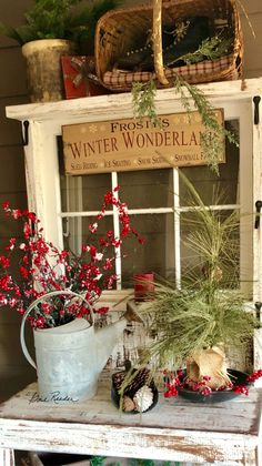 Basket sideways China cabinet florals greens small folk art garland around stuff I put in there Christmas Porch, Prim Christmas, Christmas Signs, Christmas Projects, Winter Christmas, Vintage Christmas, Christmas Ornaments, Christmas Ideas, Cabin Christmas Decor