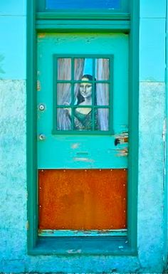 Painted door - Mona Lisa welcomes you in Silver City, New Mexico - photo by Chrispea