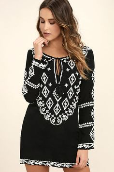 Spend an afternoon strolling the beaches in the A Day in the Life Black and White Embroidered Dress! Gauzy woven rayon with white embroidery and gold sequin accents falls to long sleeves and a tying neckline with tasseled ends. Shift silhouette.