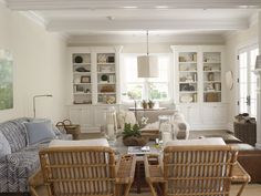This isn't a dining room but I like the idea in my dining area to have narrow shelving on either side of the window similar to this
