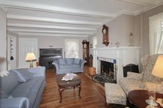 Living Room with Beamed Ceiling, Fireplace and Built-ins