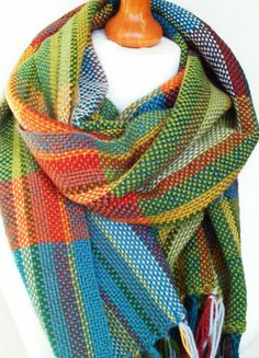 Inspired by the colours of Autumn/Fall, this scarf has been handwoven in beautiful complimentary shades of green, blue, orange, yellow, grey