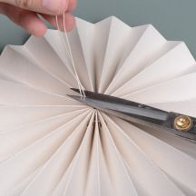Cut-of-excess-string Paper Medallions, Hole Puncher