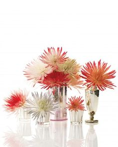 Fiery Flowers Display Inexpensive and readily available, spider mums can be tinted to look like fireworks. Group blooms of different colors in assorted vessels for a dazzling display.