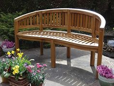 This sublime teak bench curves for convenience and a welcoming layout with a…