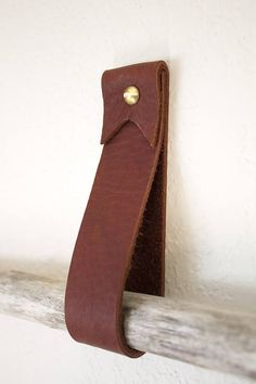 Leather straps are very durable. They are a great way to add life to boring walls and help keep your home, office, or craft space organized and clean. They can be used in a wide verity of ways, you can use just one as a towel hanger in kitchen or bathroom. Use two of them spaced apart with a
