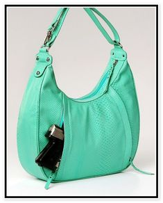 Cute Concealed Carry Purses, the pocket is well hidden, almost invisible! This would go great with my Tiffany gun!!