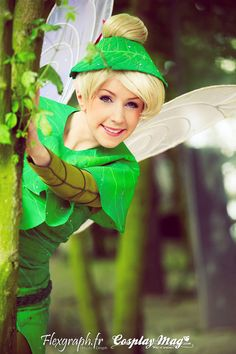 tinkerbell behind a tree by *clefchan on deviantART  I want to cosplay Tink SO BAD.