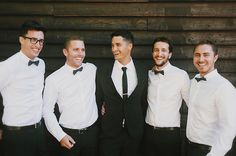 groom and groomsmen in classic black and white. Mixing it up with bow ties for the boys and a slim black tie for the main man.