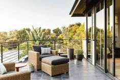 """<p class=""""MsoNormal""""><span>Framed by a gleaming metal railing, the upstairs deck with its clubby wicker seating offers a bird's eye view of the low-maintenance yard below.</span></p><p><em>Copyright 2014 Sunset Publishing Corporation, photo by Thomas J. Story. SUNSET is a registered trademark of Sunset Publishing Corporation and is used with permission.</em></p>"""