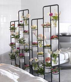 ways to Find indoor garden spaces Got garden dreams but only a small apartment? Try a room divider to make a vertical flowerbed.Got garden dreams but only a small apartment? Try a room divider to make a vertical flowerbed. Decor, Plant Stand, Apartment Garden, Vertical Garden Indoor, Ikea Plant Stand, Ikea Plants, Diy Room Divider, Room With Plants, Flower Stands