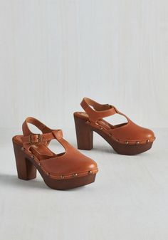8c99512dee1d Florence and the Mystique Heel in Cognac. Step into these tan leather clogs  and out into the city to flaunt your unforgettable charisma!