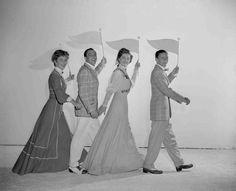 Full publicity shot of Betty Garrett as Shirley Delwyn, Gene Kelly as Eddie O'Brien, Esther Williams as K.C. Higgins and Frank Sinatra as Dennis Ryan, all holding baseball pendants.