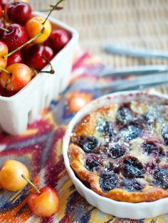 Recipe for Cherry Clafouti (a traditional French dessert) baked in individual gratin dishes.