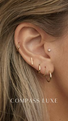 Mix and matching our 14k Compass Luxe earrings! Ohrknorpel Piercing, Bijoux Piercing Septum, Ear Piercings Helix, Cartilage Jewelry, Double Cartilage Piercing, Pretty Ear Piercings, Ear Peircings, Different Ear Piercings, Multiple Ear Piercings