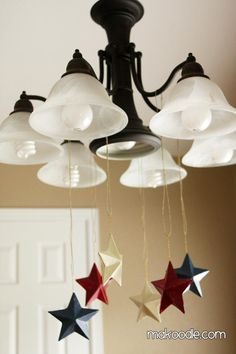 DIY 4th of July Decor -- spray paint some paper mache star ornaments red, white, and blue, and hang on a chandelier!