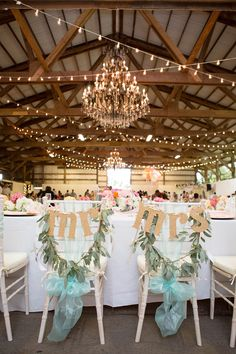 glittery chair signs, photo by Ashley Goodwin http://ruffledblog.com/kate-spade-inspired-wedding-in-hawaii #chairsigns #mrandmrs