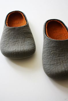 I love the look of felt slipper, I don't like the price.  I feel like I should be able to make them myself.  These are from Lithuania. The company name is osmanufacture.