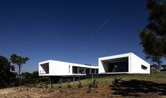 """Residential Architecture: U House by Jorge Graca Costa: """"..The U House located in Ericeira, Portugal, a World Surfing Reserve, was designed for José Gregório three times national Surf champion and a well known big wave rider, his wife and two daughters. This 300 Square meter house occupies a big lot, surrounded by a dense mesh of trees, on top of a hill overlooking Saint Lorenzo Bay. Our mutual interest in sustainability didn't keep us from wholeheartedly embracing modern design. The goal…"""