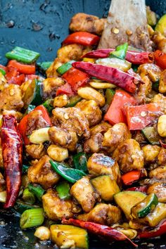 This Kung Pao Chicken is a delicious stir-fry loaded with chunky veggies and chicken and coated in a homemade tasty sauce. Ready in 30 minutes and way better than take-out! Chinese Dishes Recipes, Healthy Chinese Recipes, Chinese Chicken Recipes, Asian Recipes, Healthy Recipes, Ethnic Recipes, Healthy Food, Steak And Shrimp, Chicken Steak